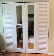 louvered bifold closet doors. Brilliant Louvered A Combination Of Plantation Louvered Doors And Mirror Are Used To  Make Up These Bifold Closet Doors Intended Louvered Bifold Closet Doors