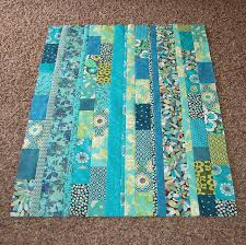 turquoise quilt top | Scrap, Fabrics and Strip quilts & Cute idea for if you have scraps that are all one color scheme or could buy  cute bits of fabric. easy idea for Project Linus quilts. Adamdwight.com