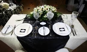 Wedding table setting with classy black and white tablecloth