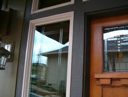 the windows next to the door have polished v goove glass we have many options of v groove to enhance your style of home