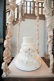 we love how the swing below was covered in fabric to match the ribbon design of the cake