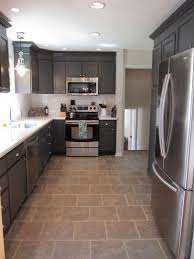 kitchen floor tiles with white cabinets. Divine Grey Cabinetry Kitchen Set Also Chrome Panel Appliances Feat Cool White Granite Countertop Brown Ceramic Floor Tile As Decorate In L Shape Tiles With Cabinets