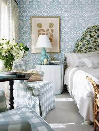 mark d sikes montecito vacation home bedroom fl upholstered headboard skirted round table gingham armchair ikat wallpaper