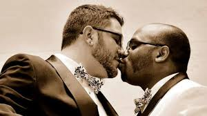 how my husband helped me see racism and my dad set aside prejudice  from left john and tommy fisher klein share a kiss on their wedding day