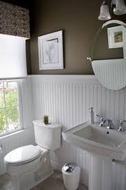 white beadboard bathroom. Dark Walls, White Beadboard Wainscot, Pedestal Sink, Pleated Bathroom O