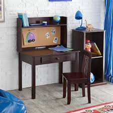 brown desk with notice board and armless chair for kids