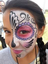 simple and pretty half day of the dead sugar skull face painting makeup by cynnamon painted at the riverside ymca event