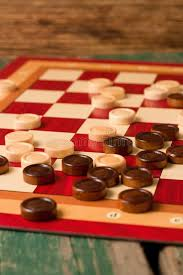 Game With Stones And Wooden Board Wooden Stones On Board For Game Of Checkers Stock Photo Image 34
