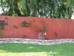protecting wood fence from dirt