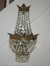 a pair of crystal mirrored chandelier wall lights