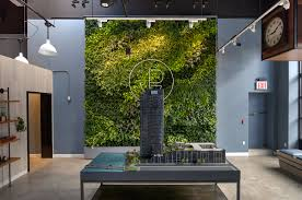 green wall office. The Greenpoint Condominium Sales Office Green Wall