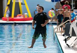 pool splash cannonball. Raphael Daniel, 9, Lantana, Competes In The Cannonball Pool Jump During Wacky Water Splash O