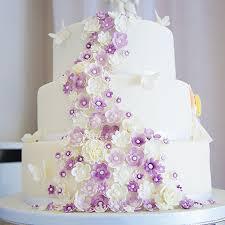 Cascading Purple Flowers And Little Girl Wedding Cake