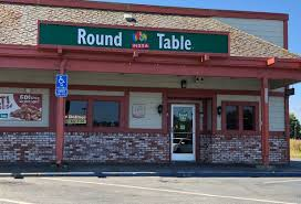 round table pizza chain serving pizzas with a variety of toppings sauces in a simple space