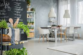 Industrial Dining Room With Chalkboard Wall In Eco Style