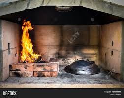 Kitchen Fireplace For Cooking Cooking Of Traditional Balkan Greek Mediterranean Croatian Meal
