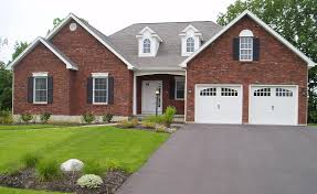 Country Brick House Design With Double Garage With White Doors And Simple  Front Yard Landscaping Also Concrete Driveway Design Cretaed By  Professional Home ...
