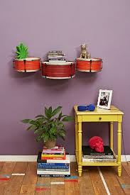 old drums as wall-mounted shelves