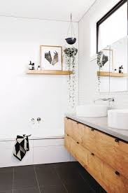 Bathroom with white honeycomb tile, a shower with a floating shelf styles  with art and