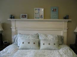 i made an old fireplace mantle into our headboard in the master bedroom over 80