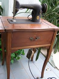 singer 66 18 in what seems to be the original cabinet with pedal hanging