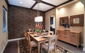 view in gallery use a low hanging pendant light or chandelier above the dining table