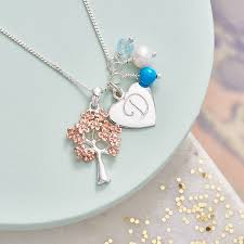 family tree necklace in rose gold with birthstones by claudette inside birthstone