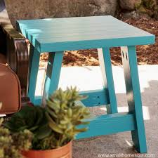 2x4 outdoor table is ready to hold a plate of bbq or a cocktail on the