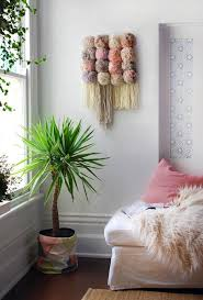 pompom wall art easy yarn wall hangings ideas to gift your friends for special occasion