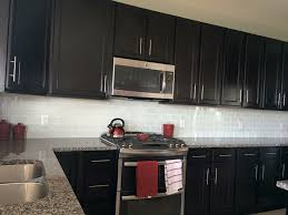 backsplash for black cabinets attractive white glass subway tile with dark within 2