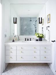 white bathroom cabinets with bronze hardware. light gray floating washstand with brass ottagon knobs white bathroom cabinets bronze hardware l