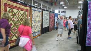 The Literate Quilter: Visitng the 2017 Quilters Showcase & The Stitching Well quilt shop of Bay City, MI organizes the showcase,  bringing together local quilt shops and quilt vendors in conjunction with a  show ... Adamdwight.com