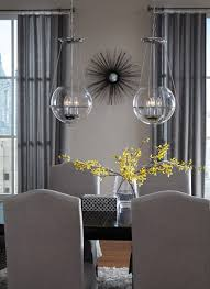 Glass pendants complete this dining room. See more options at  https://aadenlighting