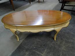 oval french provincial coffee table