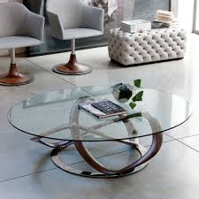 infinity glass top oval coffee table with stainless steel frame in living room with white ceramic floor tiles and tufted ottoman bench seat ideas