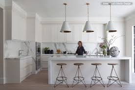 calacatta marble kitchen waterfall: marble rules in this modern kitchen calacatta oro runs along the counters and up the backsplash the island is thassos the whitewashed floor stained