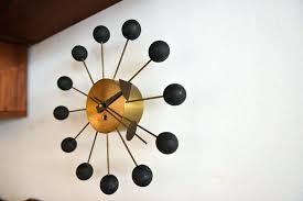 george nelson wall clocks ball clock nelson original nelson ball clock at george nelson sunburst wall clock