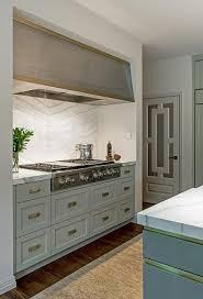 kitchen reno photos eddaa w bookmatched marble backsplash range niche drawers