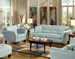 blue sofas living room: light blue leather sofa set for elegant living room interior decorating ideas with wooden coffee table