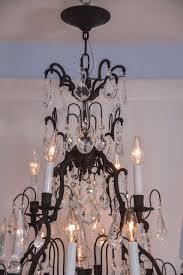 pair of versailles black finish with crystal chandeliers in excellent condition for in austin