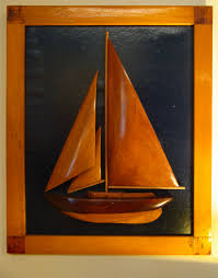 front view of mid 20th century half hull model of a sloop sailboat under sail