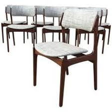 set of eight erik buck model 49 teak dining chairs