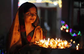 snap pa showcase a w holding a tray filled earthen lamps during diwali celebrations in allahabad