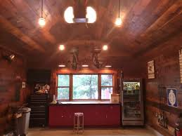 classic gooseneck barn lights give new space old garage feel