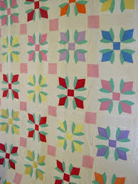 Dated/Signed 1940 Tulip Vintage Quilt | Cindy Rennels Antique Quilts & view of dated 1940 Tulip quilt hanging on a wall Adamdwight.com