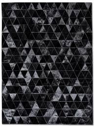 black rugs contemporary black rugs with regard to pure patchwork cowhide kahn area rug xtgzxes