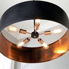 metal drum chandelier this sleek modern chandelier surrounds a five light cer with a thin metal