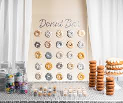 this fun diy donut bar along with donut themed prizes and giant donut cakes will pretty much round out a memorable and unique chanukah party