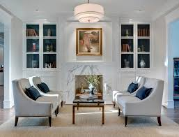 papasan chair in living room living room traditional with seating area built in bookshelves marble fireplace