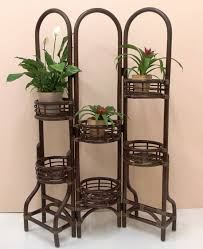 A wicker outdoor plant stand can help add elevation and enable you to be  more innovative with your outdoor patio or deck plants.